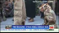 SYRIAN REBELS BEHEAD MAN