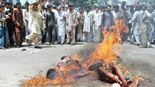 MUSLIMS BURNING CHRISTIANS