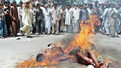 MUSLIMS BURNING CHRISTIANS 2